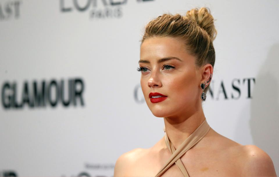 Actor Amber Heard poses at the Glamour Women of the Year Awards in Los Angeles, California, U.S., November 14, 2016. REUTERS/Mario Anzuoni