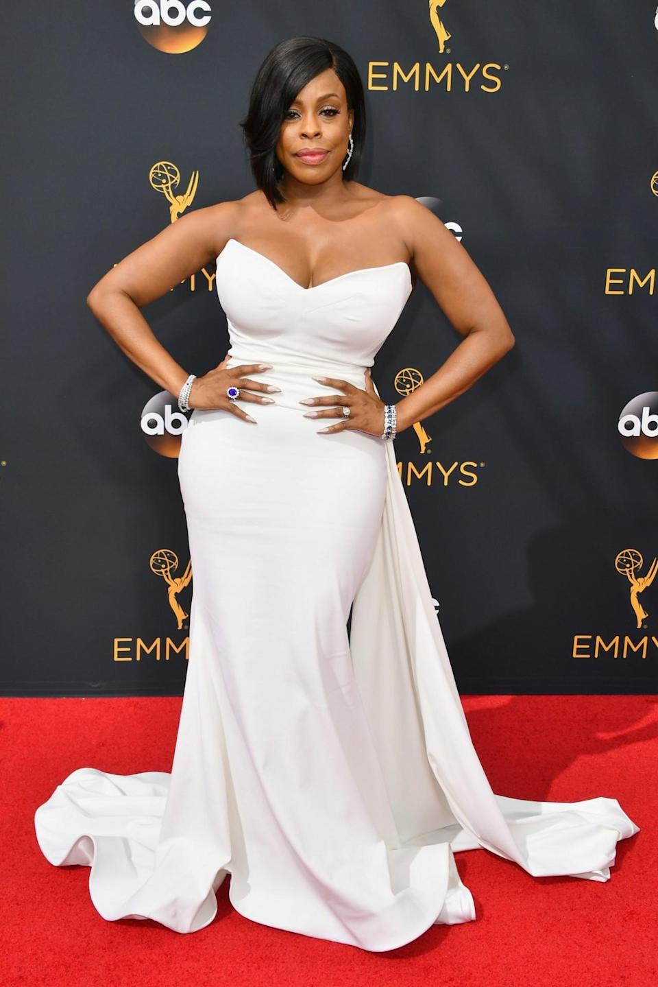 <p>Niecy Nash worked a custom piece from the designer that fit her like a glove. The strapless number also featured a train for some extra flair. <em>(Photo: Getty Images)</em></p>