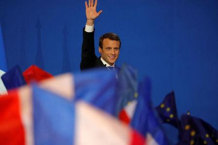 Emmanuel Macron, head of the political movement En Marche !, or Onwards !, and candidate for the 2017 French presidential election, waves to supporters after the first round of 2017 French presidential election at a polling station in Paris