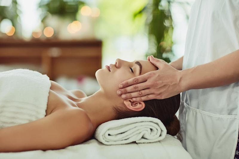 Shot of an attractive young woman getting massaged at a beauty spa