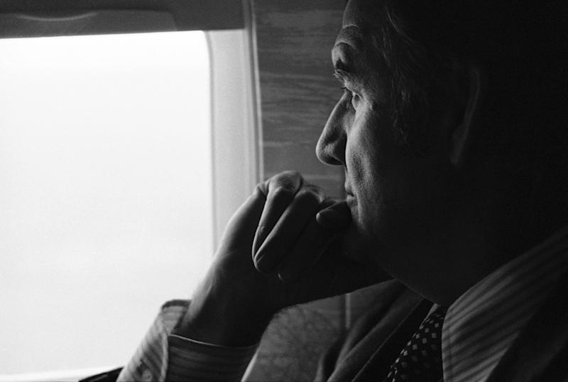 FILE - In this March 25, 1974 file photo, U.S. Senator George McGovern,looks out an airplane window on a flight to Pierre, S.D., to begin a four-day campaign swing.  A family spokesman says, McGovern, the Democrat who lost to President Richard Nixon in 1972 in a historic landslide, has died at the age of 90. According to a spokesman,  McGovern died Sunday, Oct. 21, 2012 at a hospice in Sioux Falls, surrounded by family and friends. (AP Photo, File)