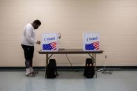 FILE PHOTO: People cast their ballot during early voting in South Carolina
