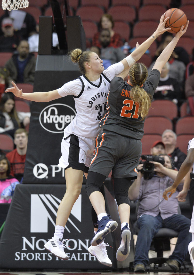 Louisville forward Kylee Shook (21) blocks the shot of Syracuse guard Emily Engstler (21) during the second half of an NCAA college basketball game in Louisville, Ky., Thursday, Feb. 7, 2019. (AP Photo/Timothy D. Easley)