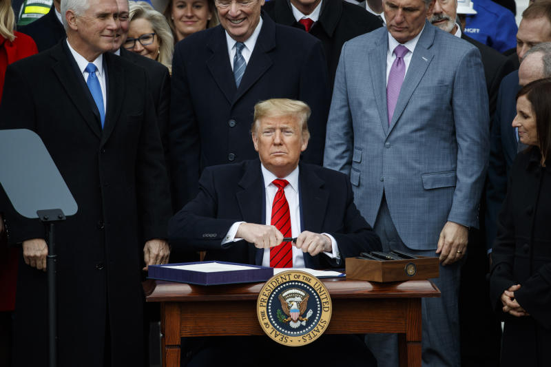President Donald Trump prepares to sign a new North American trade agreement with Canada and Mexico, during an event at the White House, Wednesday, Jan. 29, 2020, in Washington. (AP Photo/Alex Brandon)