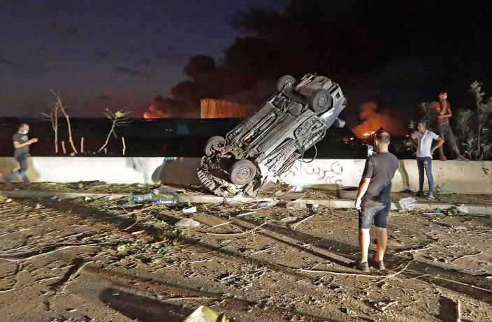 Cars overturned by the chemical explosion at Beirut's port on Tuesday. (Joseph Eid / AFP - Getty Images)