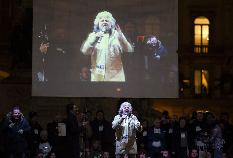 Beppe Grillo, comedian-turned-political agitator, speaks during his rally in Milan, Italy, in this Feb. 19, 2013 photo. Italians are fed up, and no one is tapping that emotional vein better than comic-turned-political agitator Beppe Grillo and his anti-establishment 5 Star Movement. Grillo's campaign is significant not only because he shows strong chances of being the third -- some project even the second, given expectations that Italians are being less than forthoming about their intentions due to embarrassment -- party in Parliament after the Sunday and Monday vote. (AP Photo/Alessandro Treves, Lapresse) ITALY OUT