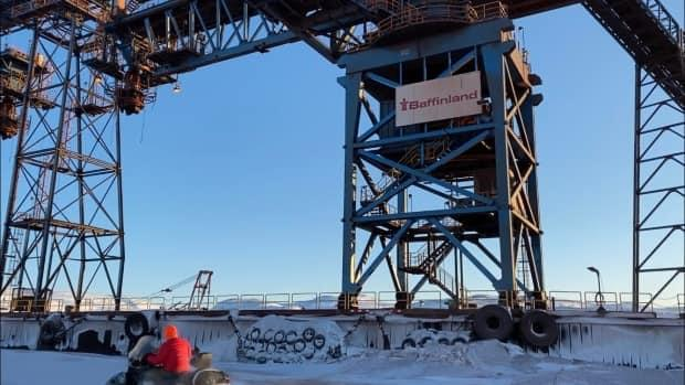 Milne Inlet in winter. An outbreak declared Sunday at the mine has now grown to 23 positive cases, causing the company to suspend operations. (Nick Murray/CBC - image credit)