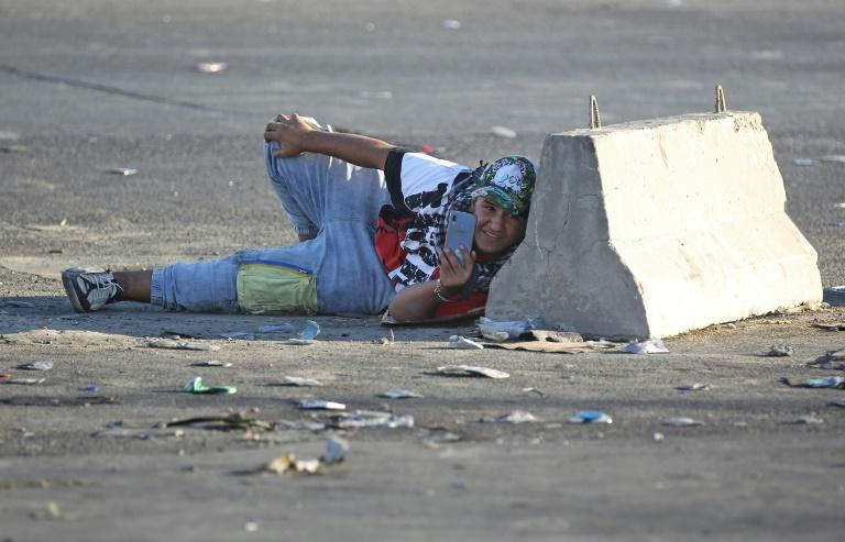 Iraqis have taken cover wherever they could as riot police fired volleys of rubber bullets and live rounds