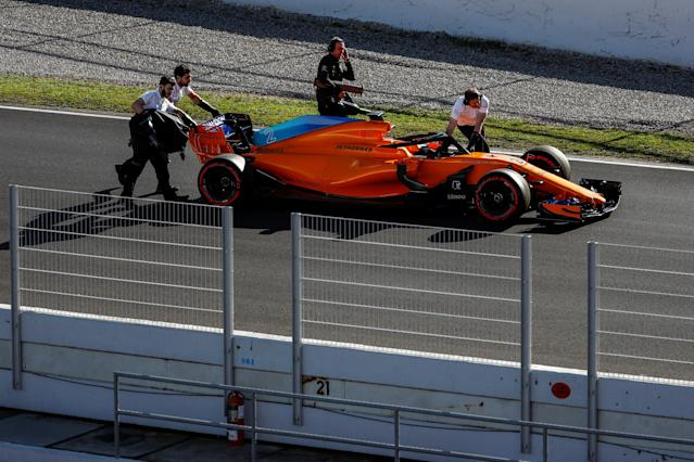 Motor Racing - F1 Formula One - Formula One Test Session - Circuit de Barcelona - Catalunya, Montmelo, Spain - March 6, 2018. The car of McLaren's Stoffel Vandoorne is taken off the track. Picture taken March 6, 2018. REUTERS/Juan Medina