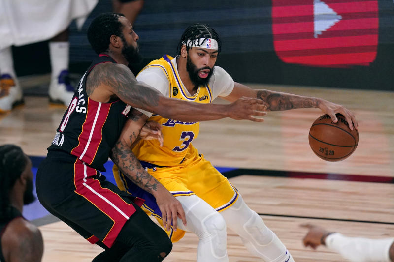 Los Angeles Lakers' Anthony Davis (3) is covered by Miami Heat's Andre Iguodala (28) as he rolls to the hoop during the first half of Game 1 of basketball's NBA Finals Wednesday, Sept. 30, 2020, in Lake Buena Vista, Fla. (AP Photo/Mark J. Terrill)