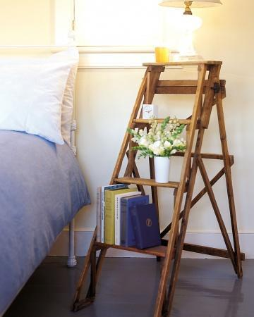 """<div class=""""caption-credit""""> Photo by: Martha Stewart Living</div><b>Stepladder Bed Stand</b> <br> Take advantage of every bit of bedroom space by stacking your nighttime necessities instead of crowding them on top of a tiny stand. The four wide rungs of an extra stepladder provide a steady spot for a row of books as well as the necessary alarm clock and reading lamp. <br> <b>Related:</b> <br> <b><a href=""""http://www.marthastewart.com/275539/bedroom-decorating-ideas/@center/277006/bedroom-and-bathroom-decorating?xsc=synd_yshine"""" rel=""""nofollow noopener"""" target=""""_blank"""" data-ylk=""""slk:23 Ways to Decorate Your Bedroom"""" class=""""link rapid-noclick-resp"""">23 Ways to Decorate Your Bedroom</a> <br> <a href=""""http://www.marthastewart.com/275280/bathroom-organization-tips/@center/277006/bedroom-and-bathroom-decorating?xsc=synd_yshine"""" rel=""""nofollow noopener"""" target=""""_blank"""" data-ylk=""""slk:24 Ways to Organize Your Bathroom"""" class=""""link rapid-noclick-resp"""">24 Ways to Organize Your Bathroom</a></b> <br>"""