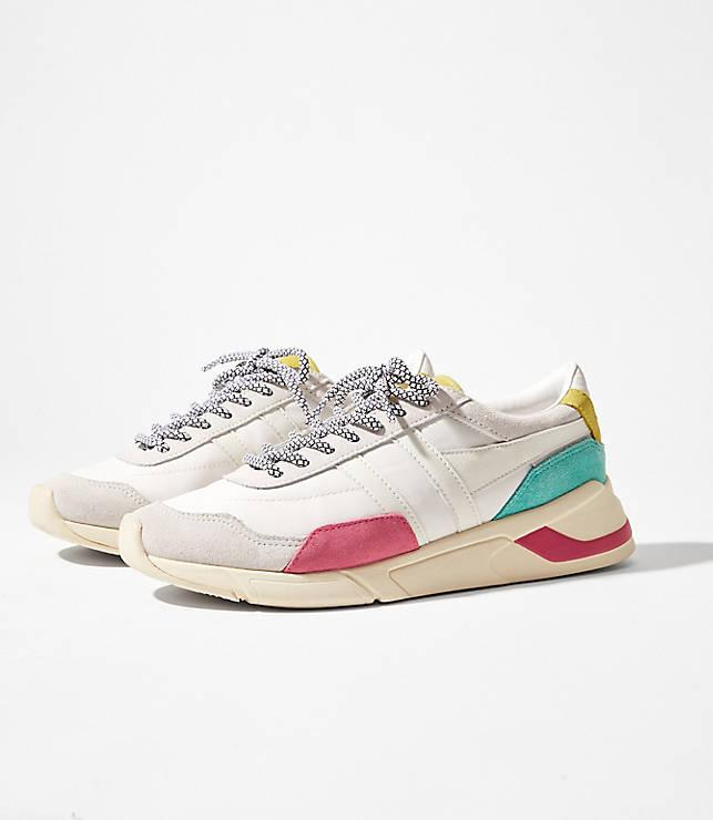 """<h3><a href=""""https://www.louandgrey.com/gola-classics-women's-eclipse-trident-trainer/539472"""" rel=""""nofollow noopener"""" target=""""_blank"""" data-ylk=""""slk:Gola Classics Eclipse Trident Trainer"""" class=""""link rapid-noclick-resp"""">Gola Classics Eclipse Trident Trainer</a></h3><br>""""I refuse to subscribe to the whole thing of wearing your bulkiest shoe because that's always a heeled bootie and I'm not trying to do that on a 7 a.m. flight. ALWAYS cute comfy sneakers or flat boots with a backup pair of long socks to cover my ankles that get super cold.""""<em> – Sloan, travels 4-5 times per year</em>""""<br><br><strong>Gola</strong> Women's Eclipse Trident Trainer, $, available at <a href=""""https://www.louandgrey.com/gola-classics-women's-eclipse-trident-trainer/539472"""" rel=""""nofollow noopener"""" target=""""_blank"""" data-ylk=""""slk:Lou & Grey"""" class=""""link rapid-noclick-resp"""">Lou & Grey</a>"""
