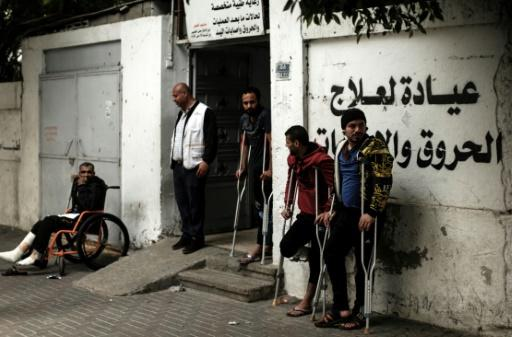 Palestinians wounded in protests against Israeli forces along Gaza's border with Israel await medical check-up at a clinic in Gaza City on April 25, 2018