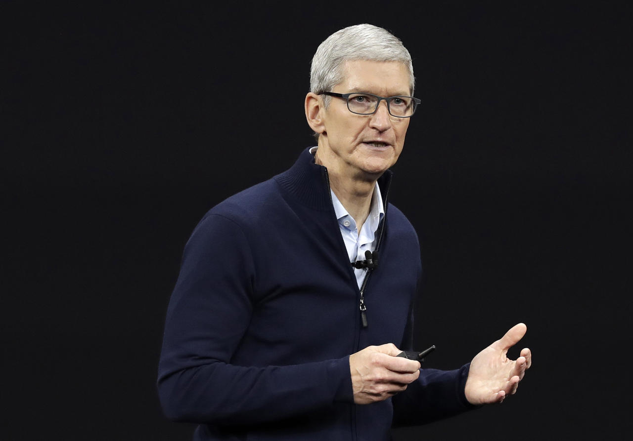 <p> FILE- In this Sept. 12, 2017, file photo, Apple CEO Tim Cook, shows new Apple Watch Series 3 product at the Steve Jobs Theater on the new Apple campus in Cupertino, Calif. Cook is leaving shareholders in suspense about whether the iPhone maker will use its windfall from a tax cut on overseas profits for a big boost to its quarterly dividend. (AP Photo/Marcio Jose Sanchez, File) </p>