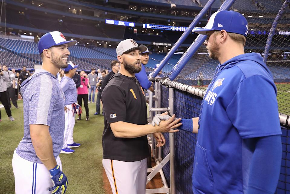 TORONTO, ON - APRIL 23: Kevin Pillar #1 of the San Francisco Giants meets with former teammates Justin Smoak #14 (R) and Randal Grichuk #15 (L) of the Toronto Blue Jays before the start of an MLB game Rogers Centre on April 23, 2019 in Toronto, Canada. (Photo by Tom Szczerbowski/Getty Images)