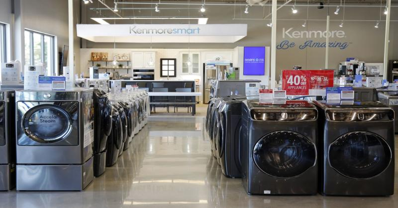 Major appliances including Kenmore® and other leading appliance brands, displayed in kitchen vignettes at the new Sears Home & Life store.