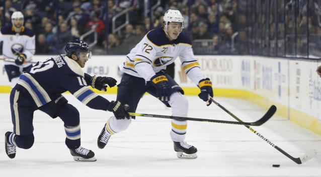 Buffalo Sabres' Tage Thompson, right, carries the puck up ice against Columbus Blue Jackets' Alexander Wennberg, of Sweden, during the first period of an NHL hockey game Tuesday, Jan. 29, 2019, in Columbus, Ohio. (AP Photo/Jay LaPrete)