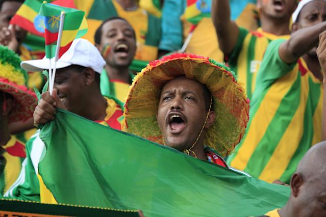 An unidentified Ethiopian fan chants before a World Cup qualifying soccer match between Ethiopia and Nigeria, at U. J. Esuene Stadium, in Calabar, Nigeria, Saturday, Nov. 16, 2013. Nigeria defeated Ethiopia 2-0 to qualify for the 2014 World Cup in Brazil. (AP Photo/Sunday Alamba)