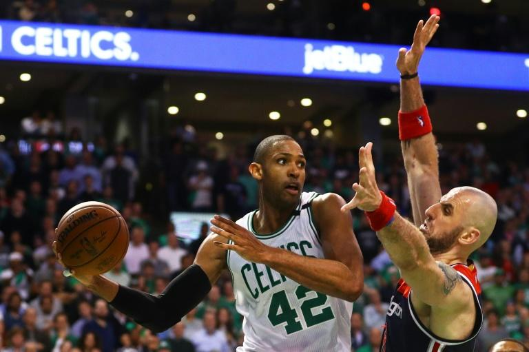 Al Horford of the Boston Celtics looks for a pass around Marcin Gortat of the Washington Wizards during Game Two of the Eastern Conference Semifinals