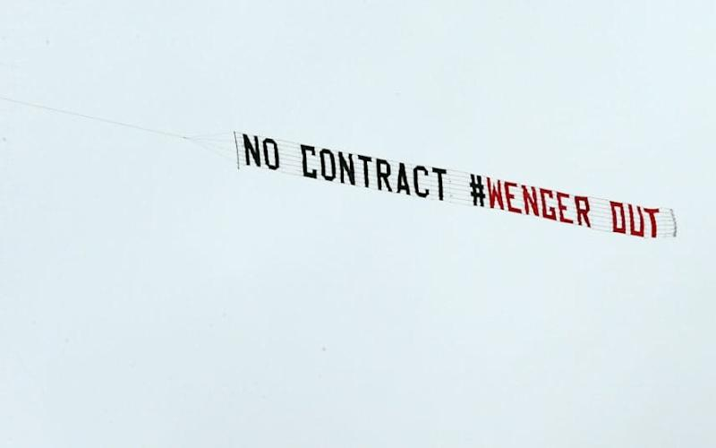 Arsenal fans fly an anti-Arsene Wenger banner over the Hawthorns  - EPA