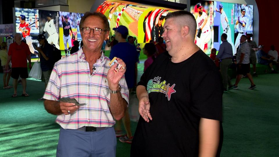Red Sox great Fred Lynn opens Topps cards from 1980 and 1987. (Yahoo Sports)