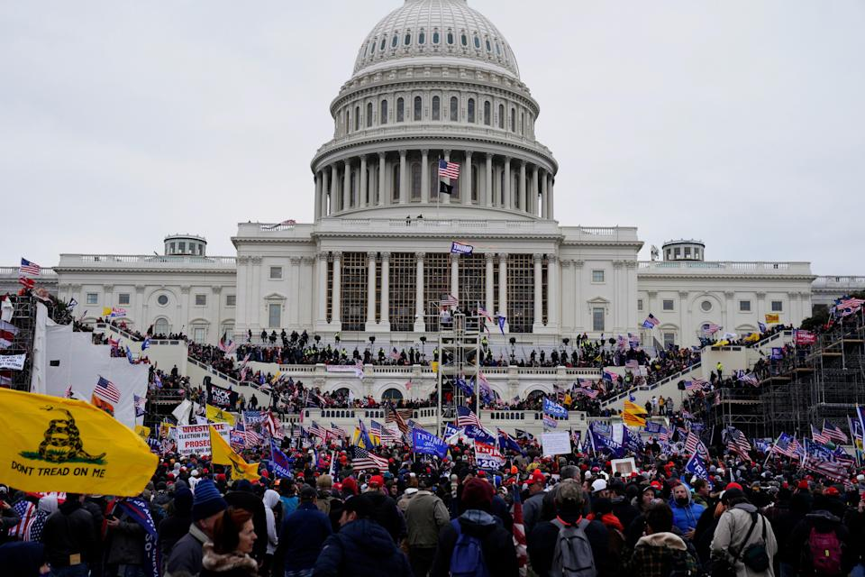 <p>Trump supporters storming the Capitol last Wednesday </p> (EPA)