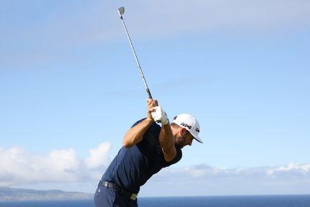 Jan 7, 2018; Maui, HI, USA; PGA golfer Dustin Johnson tees off on the 11th hole during the Sentry Tournament of Champions golf tournament at Kapalua Resort - The Plantation Course. Mandatory Credit: Brian Spurlock-USA TODAY Sports