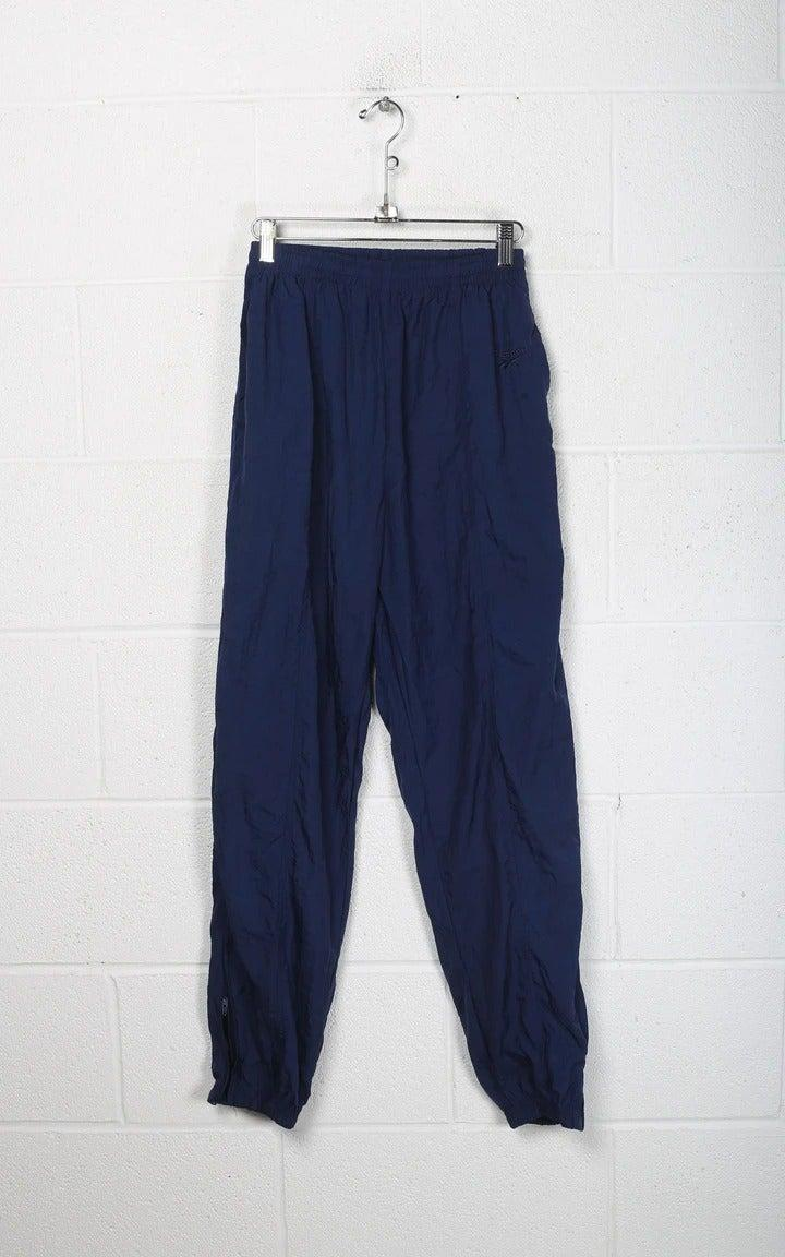 "<br><br><strong>Reebok</strong> Wind Pants, $, available at <a href=""https://frankiecollective.com/collections/reebok/products/vintage-reebok-wind-pants-32"" rel=""nofollow noopener"" target=""_blank"" data-ylk=""slk:Frankie Collective"" class=""link rapid-noclick-resp"">Frankie Collective</a>"