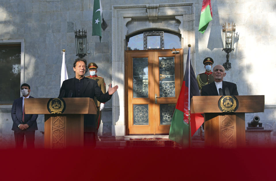 Pakistan Prime Minister Imran Khan, left, and Afghan President Ashraf Ghani speak during a joint news conference at the Presidential Palace in Kabul, Afghanistan, Thursday, Nov. 19, 2020. (AP Photo/Rahmat Gul)
