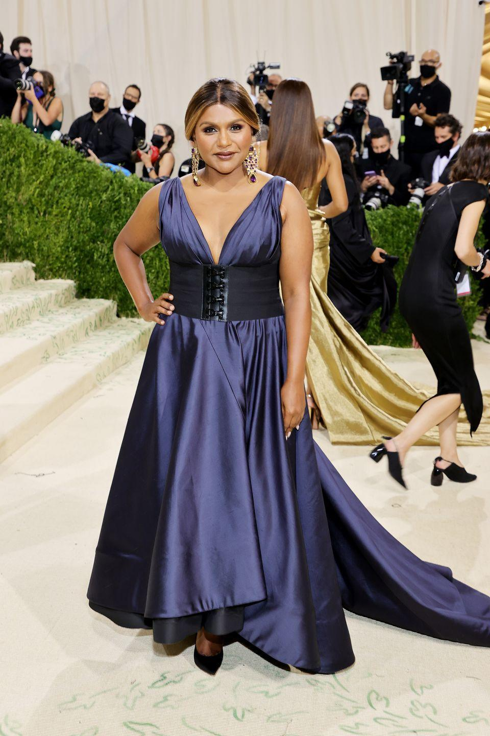<p>Mindy Kaling wore a sapphire blue satin gown for the event. </p>