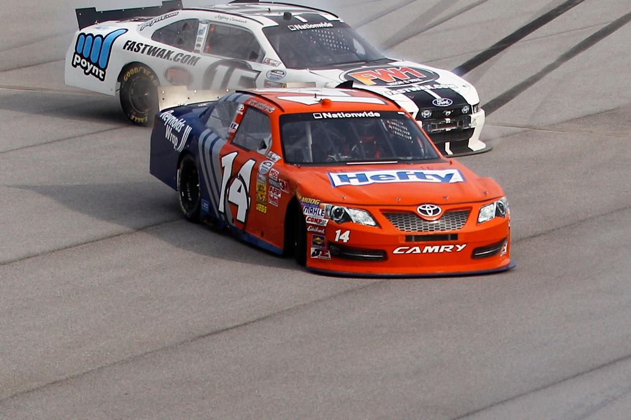 TALLADEGA, AL - MAY 05:  Eric McClure, driver of the #14 Hefty/Reynolds Wrap Toyota, spins off the track during the NASCAR Nationwide Series Aaron's 312 at Talladega Superspeedway on May 5, 2012 in Talladega, Alabama.  (Photo by Chris Graythen/Getty Images for NASCAR)