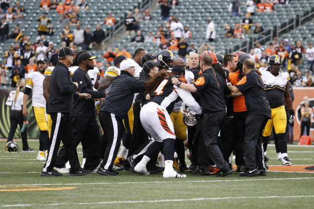 FILE - In this Dec. 13, 2015, file photo, a scrum breaks out on the field between the Cincinnati Bengals and the Pittsburgh Steelers players during practice before an NFL football game, in Cincinnati. The Bengals had two 15-yard penalties that helped the Steelers win a playoff game at Paul Brown Stadium in the 2015 season. They set a club record with 173 yards in penalties as Pittsburgh rallied to pull another one out last December. The theme for this week: Keep cool when the Steelers come to town again.(AP Photo/Frank Victores, File)