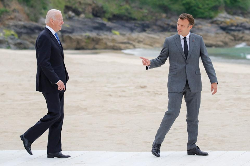 French president Emmanuel Macron (right) greets US president Joe Biden at the G7 summit (Photo: PHIL NOBLE via Getty Images)