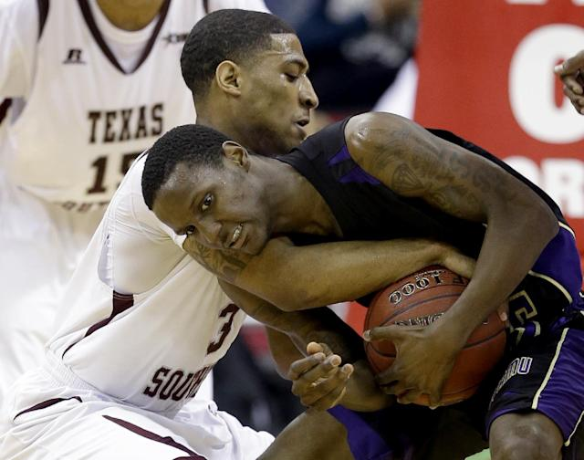 Texas Southern's Madarious Gibbs (3) forces a jump ball call with Prairie View A&M's Tre Hagood during the first half of an NCAA college basketball game in the championship of the Southwestern Athletic Conference tournament Saturday, March 15, 2014, in Houston. (AP Photo/David J. Phillip)