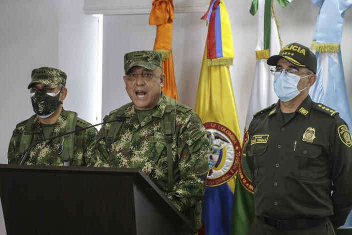 Colombian Armed Forces Commander Gen. Luis Fernando Navarro, center, National Police Director Gen. Jorge Luis Vargas, right, and Army Commander Gen. Eduardo Zapateriro give a press conference regarding the alleged participation of former Colombian soldiers in the assassination of Haiti's President Jovenel Moïse, in Bogota, Colombia, Friday, July 9, 2021. (AP Photo/Ivan Valencia)