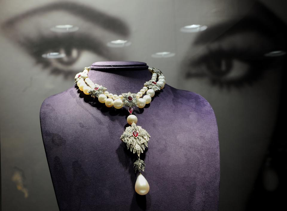 """La Peregrina"", a Cartier pearl, diamond and ruby necklace owned by US actress Elizabeth Taylor on display during a preview of The Collection of Elizabeth Taylor December 1, 2011 at Christie's in New York. The jewelry in Taylor's collection will go on sale December 13, this necklace is estimated at USD 2 million to 3 million. AFP PHOTO/Stan HONDA (Photo credit should read STAN HONDA/AFP via Getty Images)"