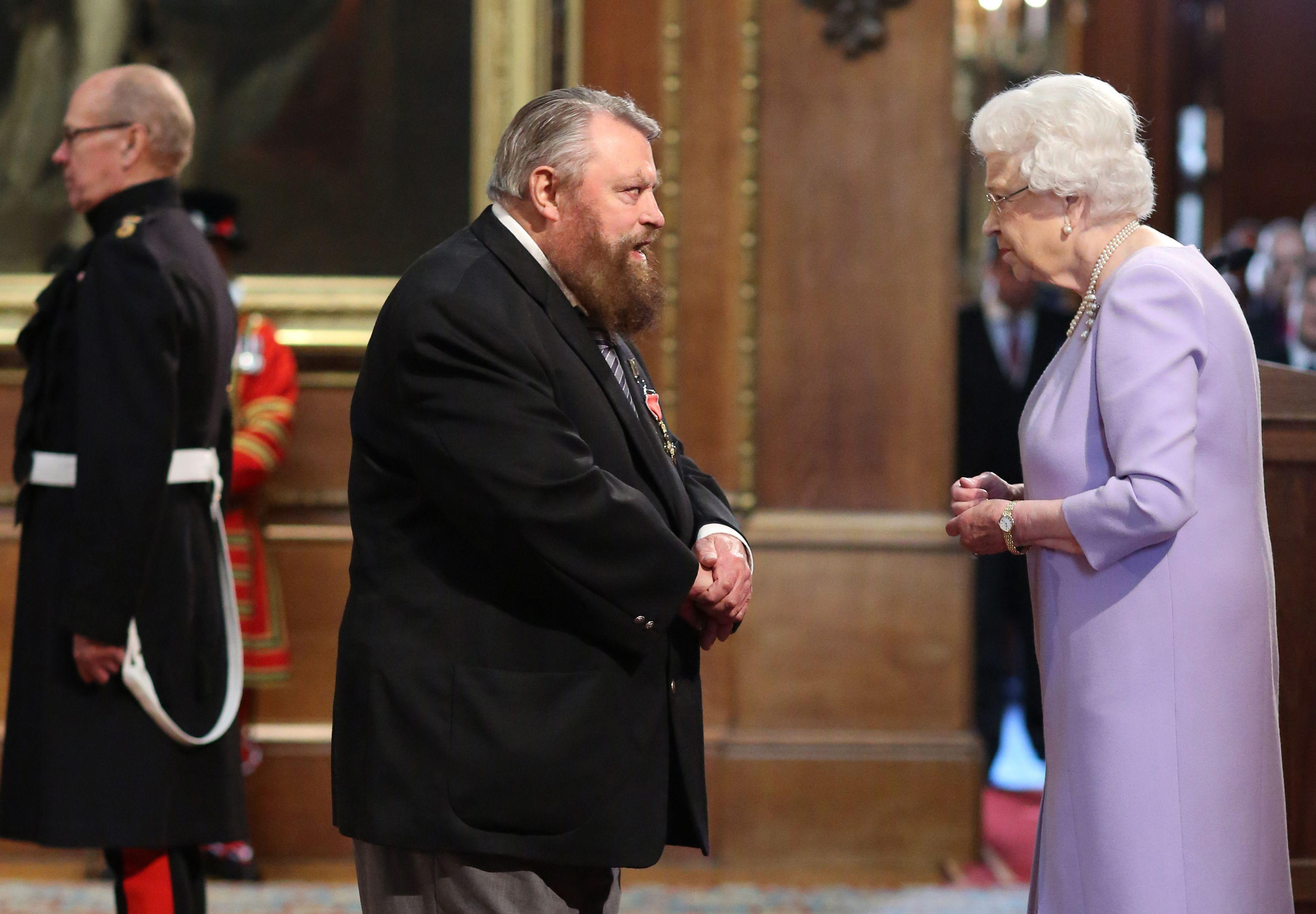 Actor Brian Blessed is made an Officer of the Order of the British Empire (OBE) by Queen Elizabeth II during an Investiture ceremony at Windsor Castle.