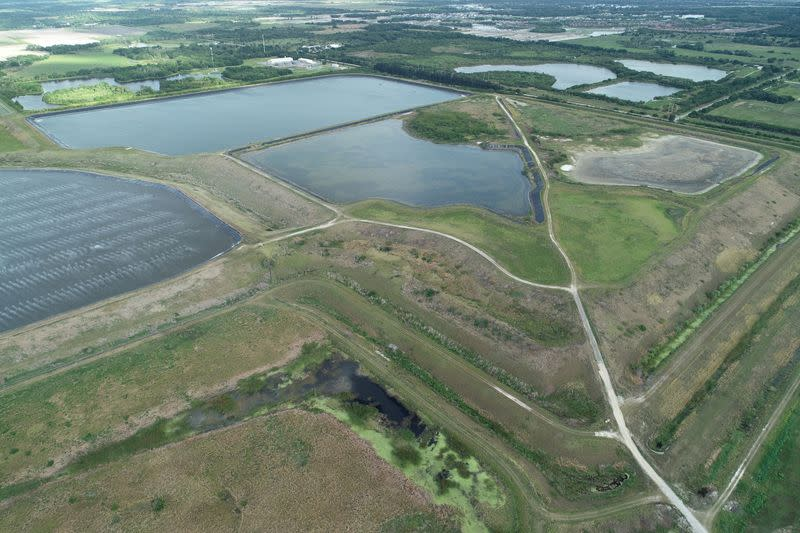 FILE PHOTO: A reservoir of an old phosphate plant is seen in an aerial photograph taken in Piney Point
