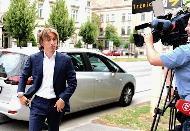 Real Madrid midfielder Luka Modric attending court in Osijek, Croatia last year to testify in the multi-million-euro corruption trial against ex-Dinamo Zagreb chief Zdravko Mamic (AFP Photo/STRINGER)