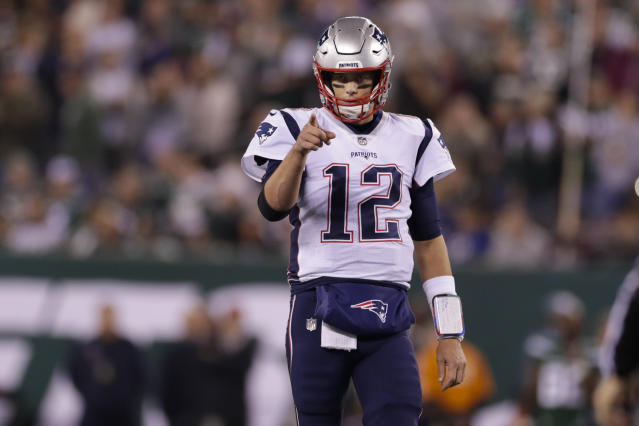 New England Patriots quarterback Tom Brady (12) points to Benjamin Watson (84) after a play during the first half of an NFL football game against the New York Jets, Monday, Oct. 21, 2019, in East Rutherford, N.J. (AP Photo/Adam Hunger)