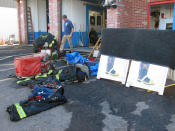 Firefighting gear rests outside a Manville, N,J. firehouse to dry on Friday Sept. 3, 2021 after the building sustained four feet of flooding from Tropical Storm Ida.(AP Photo/Wayne Parry)