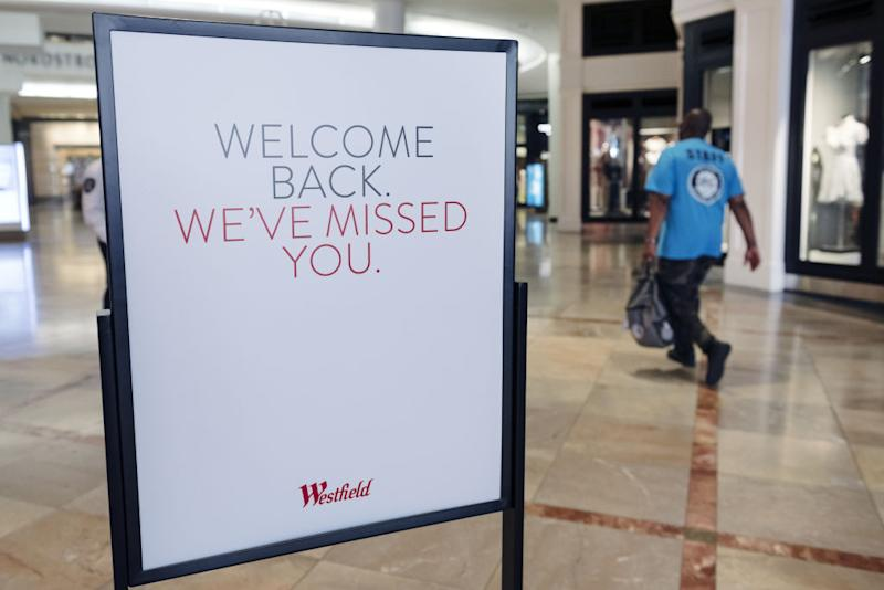 Signage welcome back shoppers at Westfield San Francisco Centre in San Francisco, California, U.S., on Thursday, June 18, 2020. San Francisco moved into Phase 2B on Monday, opening up outdoor dining and allowing customers to go inside retail stores to shop. Photographer: Michael Short/Bloomberg
