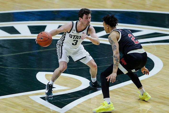 Michigan State guard Foster Loyer dribbles against Nebraska guard Trey McGowens during the first half at Breslin Center in East Lansing, Saturday, Feb. 6, 2021.