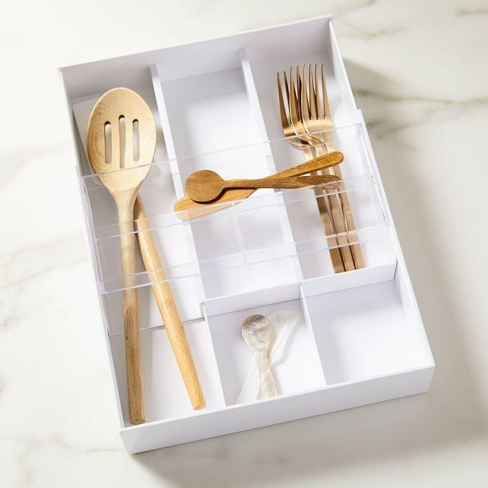 <p>We love that you can see through the <span>Yamazaki Expandable Cutlery Drawer Organizer</span> ($22).</p>