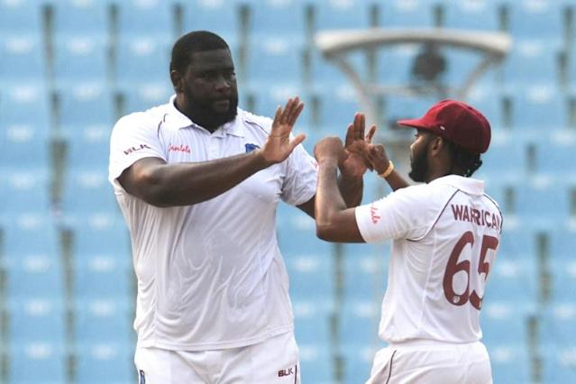 West Indies spinner Rahkeem Cornwall (L) took 10 wickets in the one-off Test against Afghanistan (AFP Photo/Rohit UMRAO)
