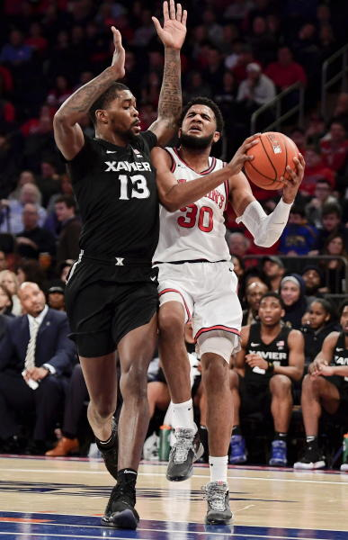 St. John's LJ Figueroa (30) is defended by Xavier's Naji Marshall (13) during an NCAA college basketball game in New York on Monday, Feb 17, 2020. (Steven Ryan/Newsday via AP)