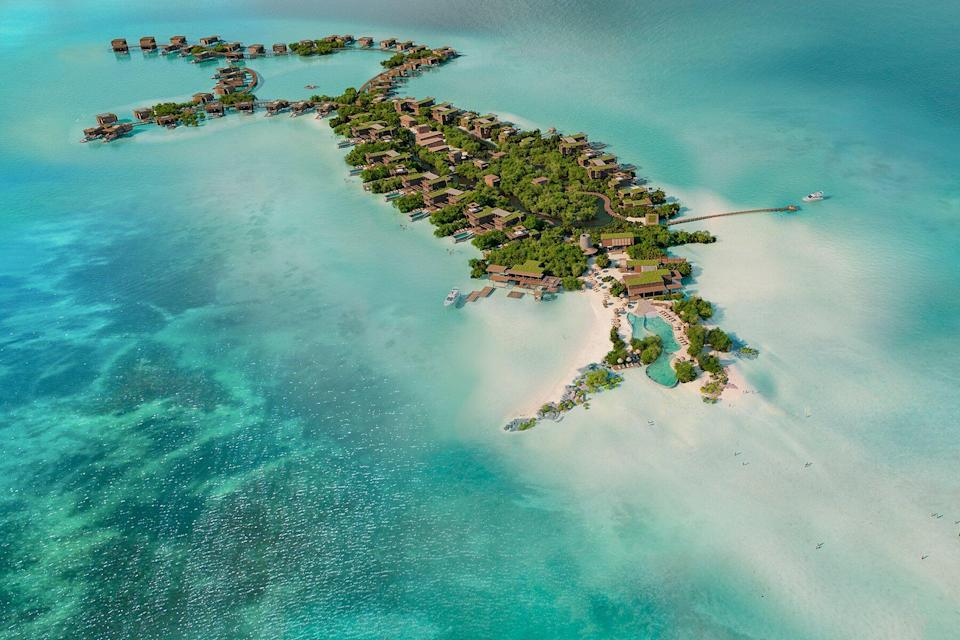 Aerial view of the resort and residences that will be set across a serene private island and a sun-drenched stretch of Secret Beach.