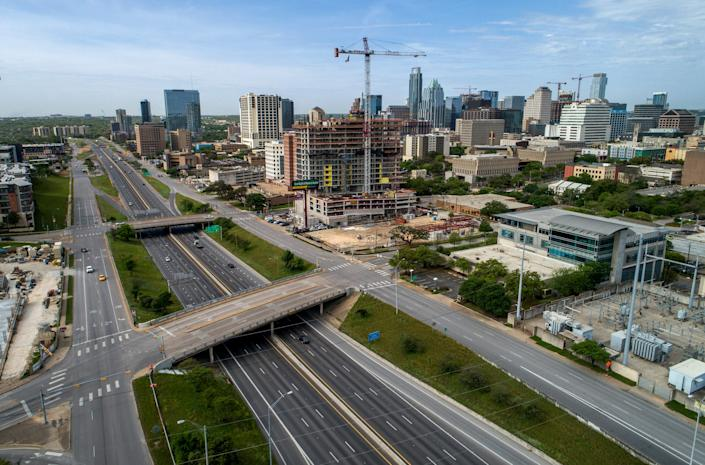 Light traffic flows on I-35 in downtown Austin on Sunday March 29, 2020, during the shelter in place order due to the coronavirus.