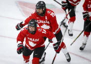 Canada's Renata Fast, left, celebrates her goal against Switzerland with teammates during the first period of an IIHF women's hockey championships semifinal in Calgary, Alberta, Monday, Aug. 30, 2021. (Jeff McIntosh/The Canadian Press via AP)