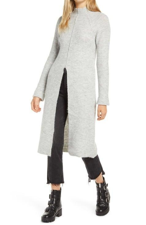 """<h2>Nordstrom</h2><br>We know, we know — this <em>isn't</em> technically a dress. (Don't be mad.) But out of the scores of business-as-usual knitwear dresses and tiered, blousy frocks on the heritage retailer's website, this split-front sweater tunic spoke to us. With a fabrication that meets sustainable standards — a blend of recycled poly, wool, and alpaca — and a shape that's part top and part frock; this garment holds endless possibilities. Do we layer it over jeans, or a slinky slipdress? What about a voluminous skirt? <br><br><strong>Vero Moda</strong> Gaiva Slit Front Long Sleeve Midi Sweater Dress, $, available at <a href=""""https://go.skimresources.com/?id=30283X879131&url=https%3A%2F%2Fwww.nordstrom.com%2Fs%2Fvero-moda-gaiva-slit-front-long-sleeve-midi-sweater-dress%2F5735056"""" rel=""""nofollow noopener"""" target=""""_blank"""" data-ylk=""""slk:Nordstrom"""" class=""""link rapid-noclick-resp"""">Nordstrom</a>"""